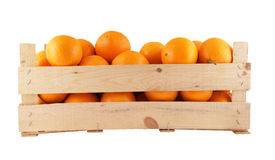 Orange fruits in wooden box isolated Stock Photos