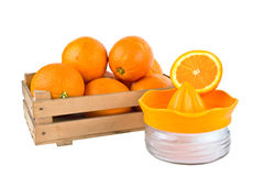 Orange fruits in a wooden crate isolated on white Royalty Free Stock Image