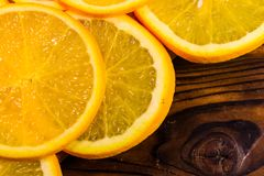Orange fruits on wooden table. Top view. Ripe orange fruits on a wooden table. Top view Royalty Free Stock Image