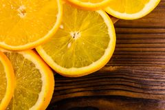 Orange fruits on wooden table. Top view. Ripe orange fruits on a wooden table. Top view Royalty Free Stock Images