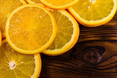 Orange fruits on wooden table. Top view. Ripe orange fruits on a wooden table. Top view Royalty Free Stock Photography