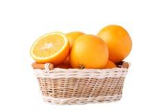 Orange frukt i korg på en vit bakgrund royaltyfria bilder