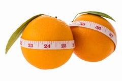 Orange frukt och mätaband royaltyfria foton
