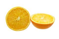 Orange frukt och två som klipps i halva Arkivbild