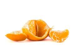 Orange frukt som skalas av arkivfoton
