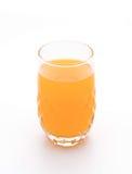 Orange fruktsaft i exponeringsglas Arkivbild