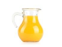 Orange fruktsaft i kanna arkivfoton