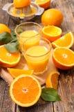 Orange fruktsaft och apelsin Royaltyfria Foton