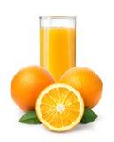 Orange fruktsaft och apelsiner Royaltyfria Bilder