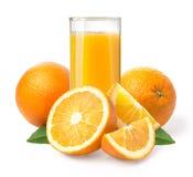 Orange fruktsaft och apelsiner Fotografering för Bildbyråer