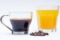Orange fruktsaft och kaffe royaltyfria bilder
