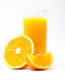Orange fruktsaft och skiva Royaltyfria Bilder