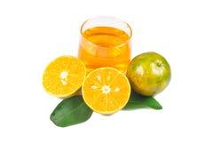 Orange fruktsaft och skivor Arkivbilder
