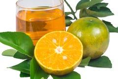 Orange fruktsaft och skivor Arkivfoto