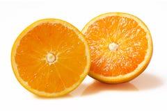 Orange fruktskiva på vit bakgrund Arkivbilder