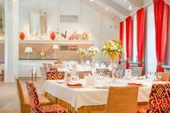 Orange fuchsia flower arrangement wedding decoration. In restaurant Stock Image