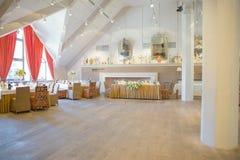 Orange fuchsia flower arrangement wedding decoration. In restaurant Royalty Free Stock Photography