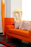 Orange furniture. Orange sofa close up made from plush Stock Image