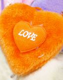 Orange fuzzy heart. Fuzzy orange heart with love written on it Royalty Free Stock Photo
