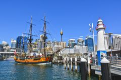 Orange Galleon Ship on Body of Water Beside City Buildings Stock Photo