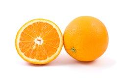 Orange. Ganzes und halbes Lizenzfreies Stockfoto