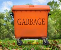 Orange garbage bin Royalty Free Stock Photos