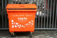 Orange garbage can Stock Photos