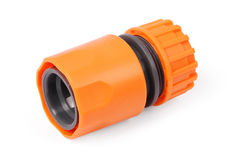 Orange garden water hose nozzle and connectors Royalty Free Stock Photography