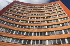 Orange Gebäude des Geschäfts Stockbilder