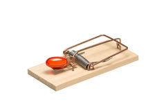 Orange Gelatin Capsule in a Mousetrap Royalty Free Stock Photos