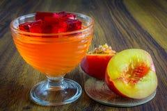 Orange Gelee mit Frucht Stockbild