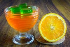 Orange Gelee mit Frucht Stockbilder