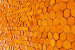 Orange geometric background with honeycombs stock images