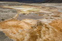Orange geothermal pools and travertine rock of Mammoth Hot Sprin Stock Photo