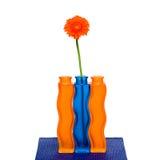 Orange gerbera flower in vase on white background Royalty Free Stock Images