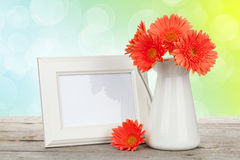 Orange gerbera flowers and photo frame Royalty Free Stock Photography