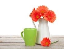 Orange gerbera flowers in pitcher Stock Photography
