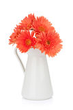Orange gerbera flowers in pitcher Royalty Free Stock Photography