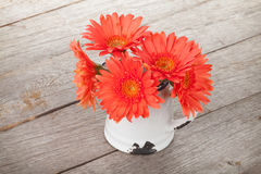 Orange gerbera flowers in pitcher Royalty Free Stock Photo
