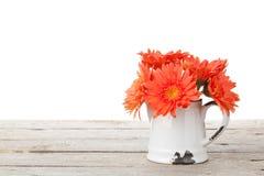 Orange gerbera flowers in pitcher Stock Photo