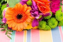 Orange Gerbera with fresh florist flowers. Copy space. Royalty Free Stock Photos