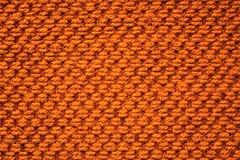 Orange Gewebemuster-Textilhintergrund Stockbild