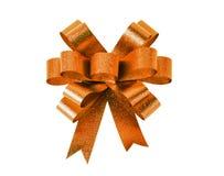 Orange gift bow. Ribbon. Isolated on white Royalty Free Stock Photos