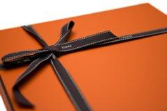 Orange gift box Stock Photos