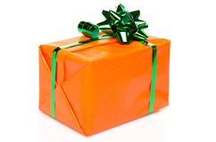 Orange gift box with a green bow Royalty Free Stock Images