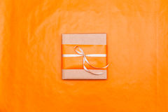 Orange gift box Stock Images