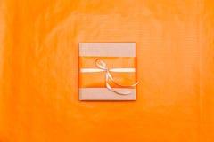 Orange gift box Stock Images