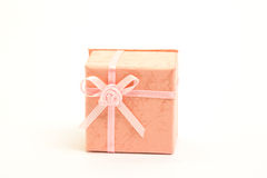 Orange gift box with pink ribbon Royalty Free Stock Image