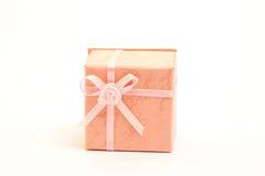 Orange gift box with pink ribbon Royalty Free Stock Image