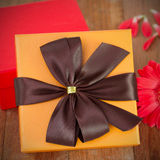 Orange gift box with flower Royalty Free Stock Photography